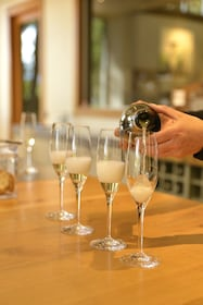 White wine being poured into glasses on the Full Day Wine Tour in Marlborough, New Zealand