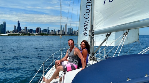 Couple on bow of sailboat on Lake Michigan