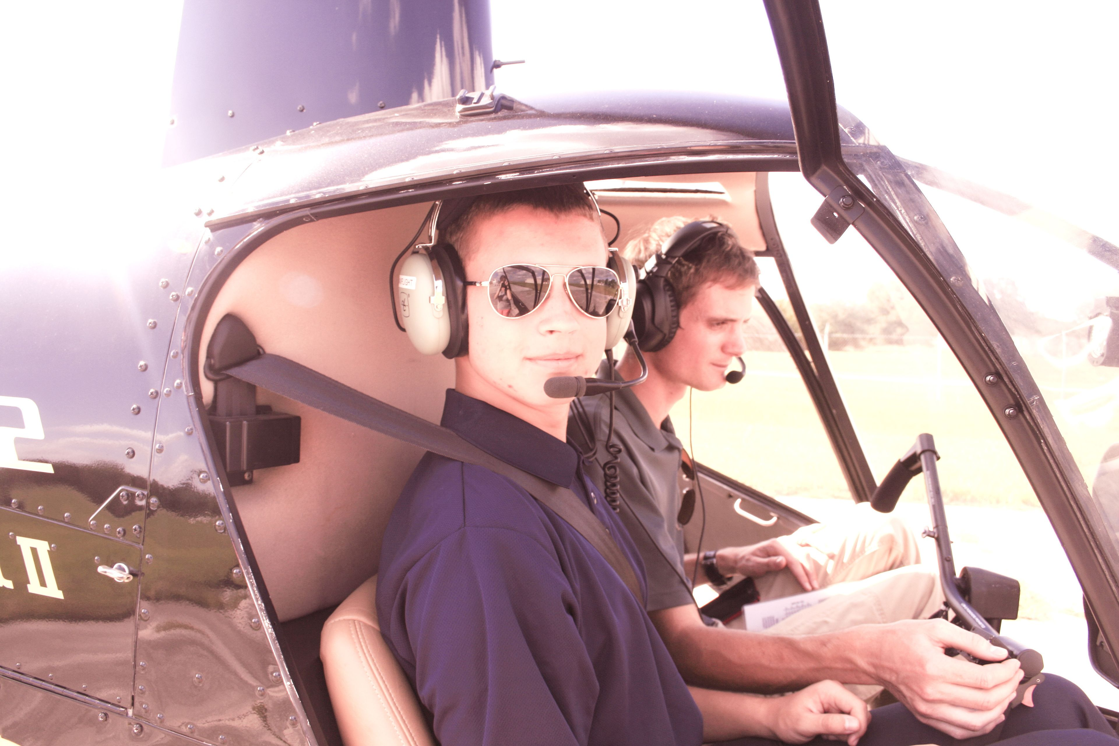 Pilot and student before takeoff in helicopter in Kissimmee, Florida