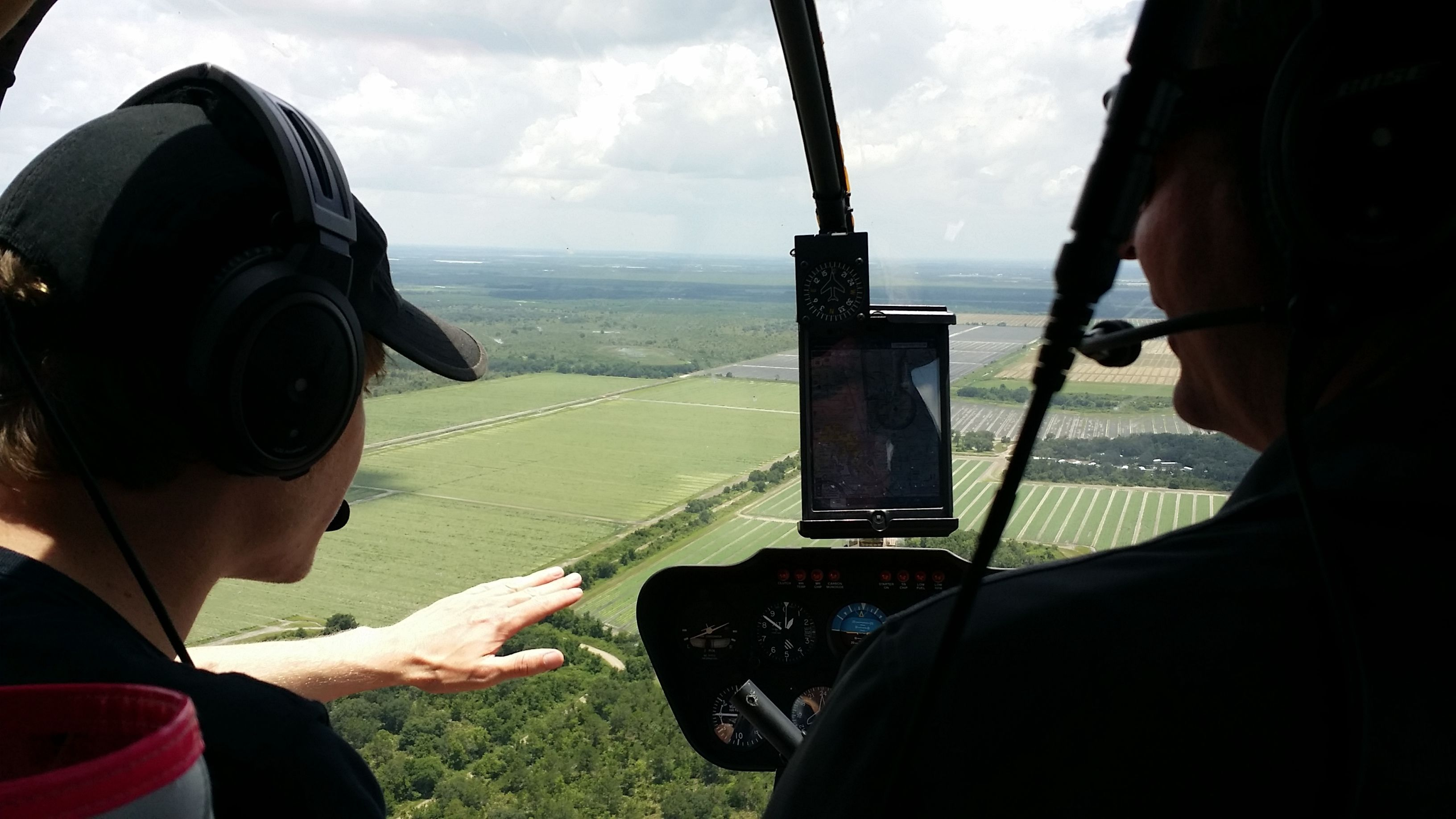 Pilot and student flying in helicopter in Kissimmee, Florida