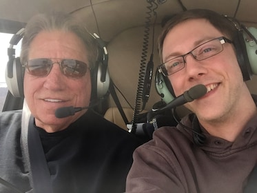 Pilot and student take selfie in helicopter in Kissimmee, Florida