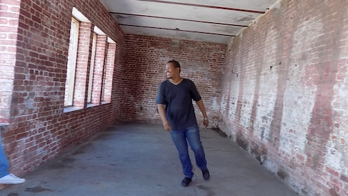 Man in a brick corridor in Port Royal
