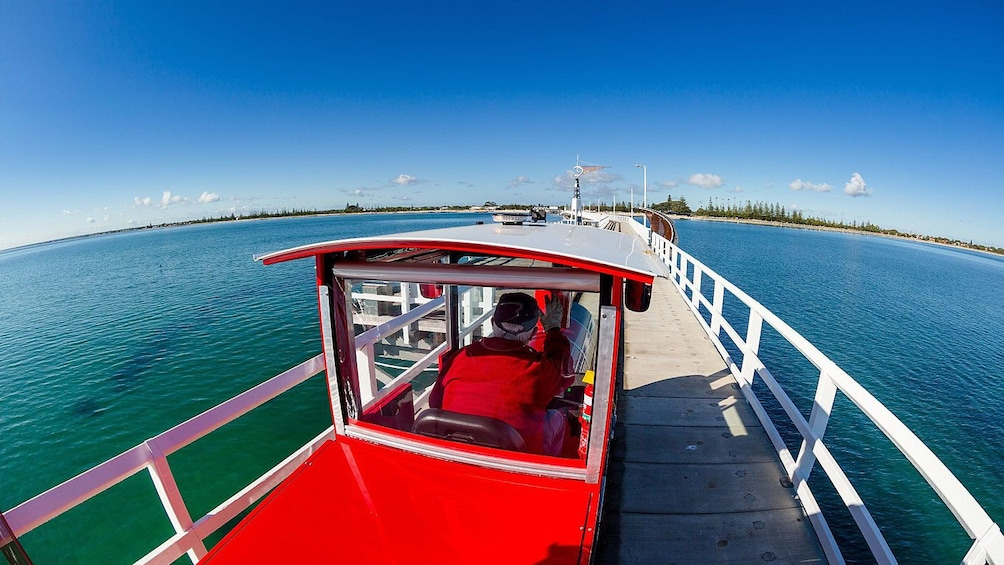 View of small train traveling across Busselton Jetty