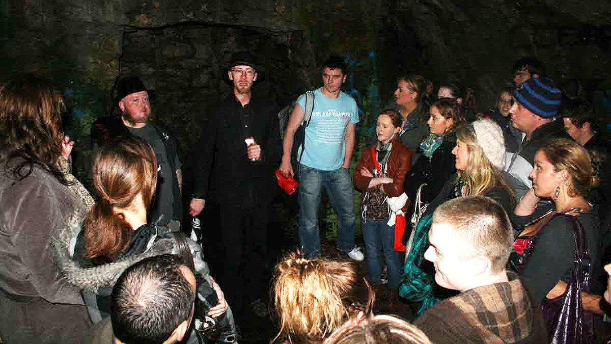 Group listening to tour guide at the Hell Fire Club in Dublin