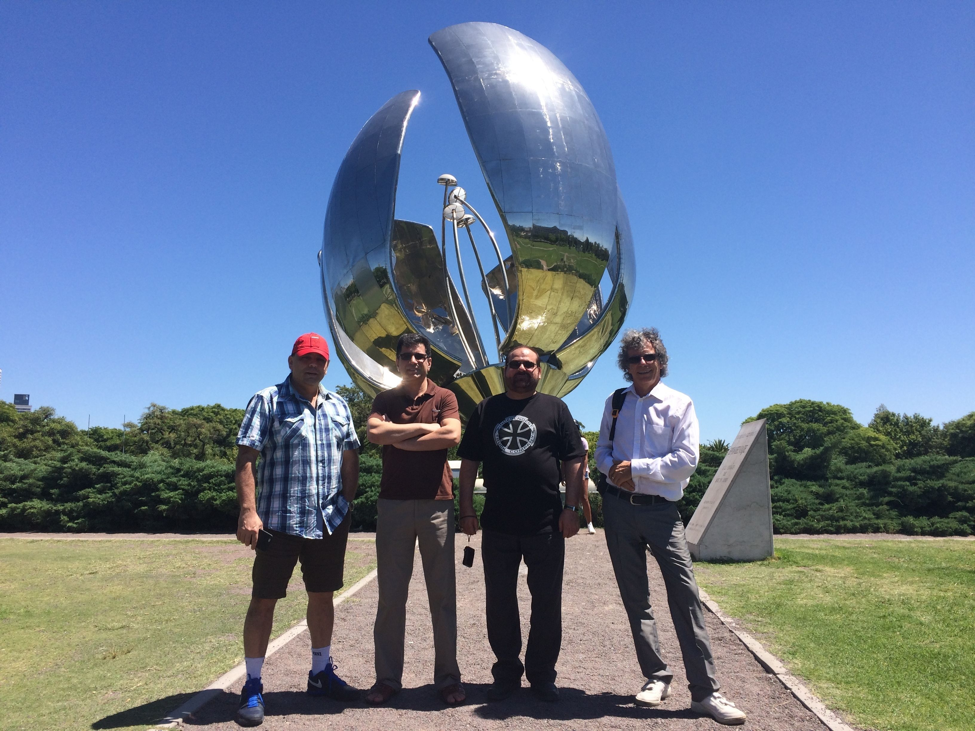 Group standing in front of giant artwork in Buenos Aires