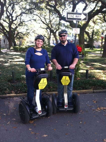 Show item 2 of 2. Couple on segways during tour of Savannah