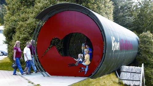 Kids playing on a tube-like structure at Kiwi Birdlife Park in Queenstown
