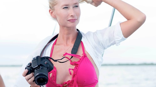 Woman holding a camera on the Sian Kaan Sunset Motorboat