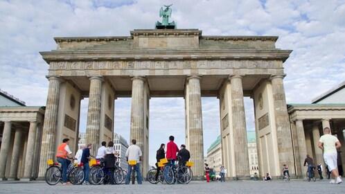Bicycling group at Brandenburg Gate in Berlin
