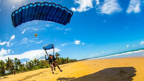 Sky divers landing safely on a beach in Australia