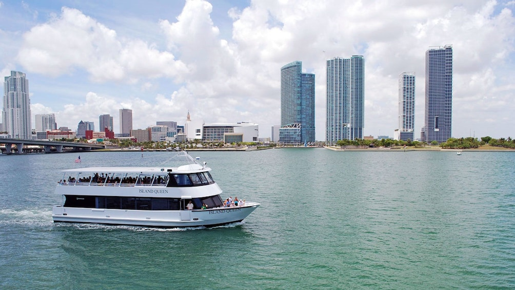Show item 1 of 10. Tour boat traveling past Miami skyline