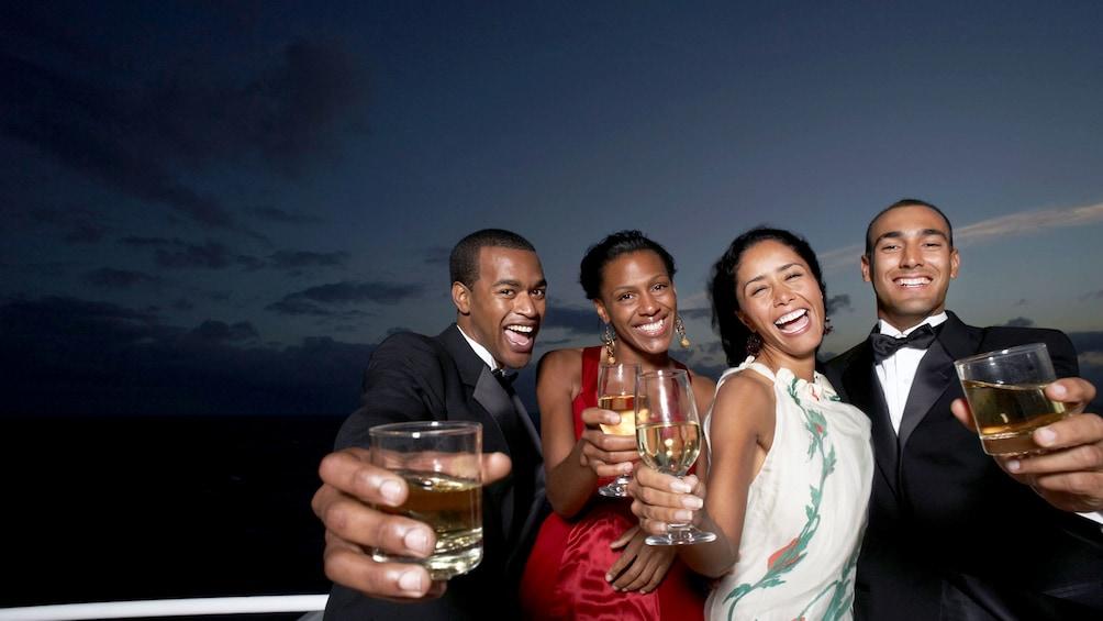 Show item 1 of 5. Group enjoying drinks on cruise