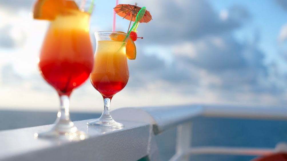 Show item 2 of 5. Cocktails on rail of cruise