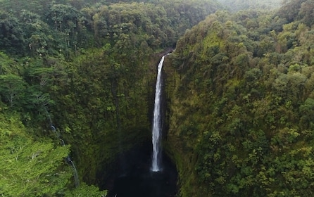 Waterfall in Hawaiian jungle seen from Helicopter