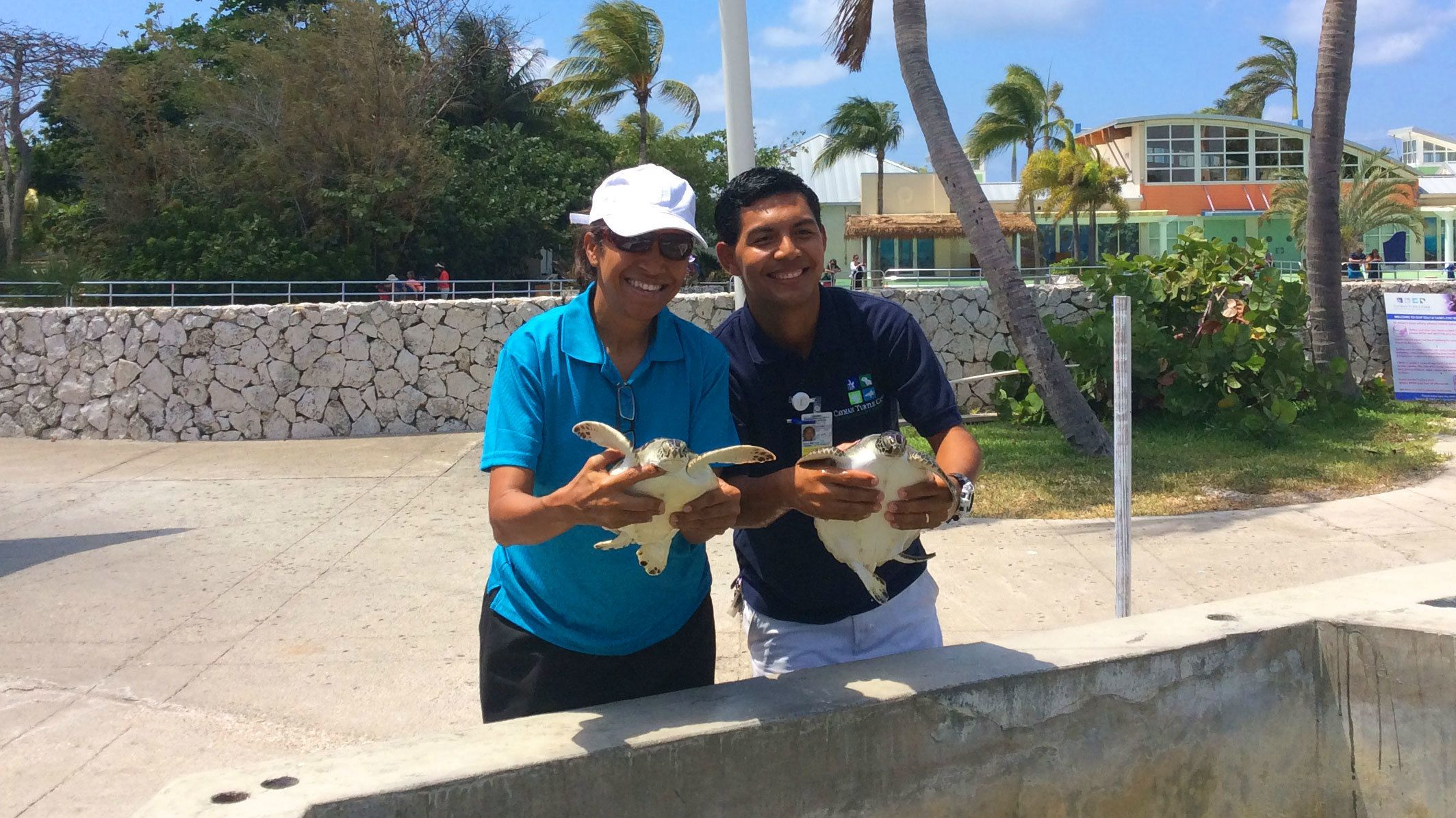 Two zookeepers at the Cayman Turtle Center