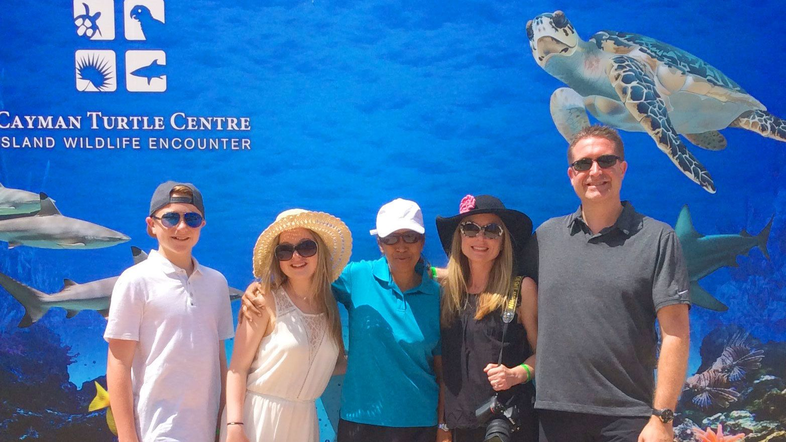 Family poses for a picture outside the Cayman Turtle Center