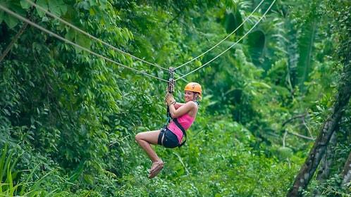 Woman ziplining in Belize