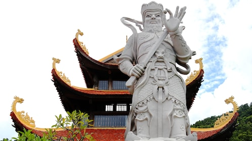 Large stone statue in front of temple in Phu Quoc
