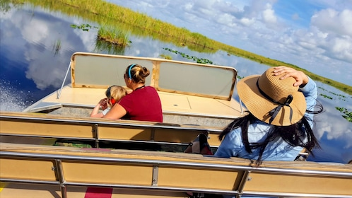 Small group of people on an airboat in the Everglades