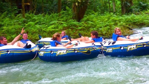 People floating down a river in Jamaica