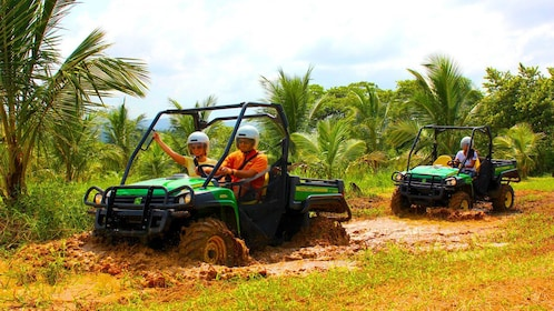 People on ATVs in the mud in Jamaica