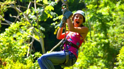 Woman on a zip line in a jungle