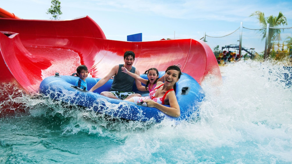 Show item 2 of 10. Family on a waterslide at Legoland in Dubai