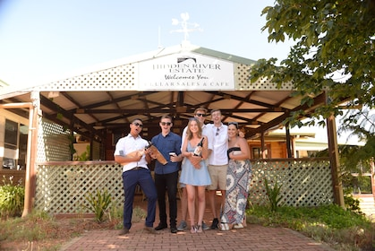 Group at Hidden River Estate drinking wine