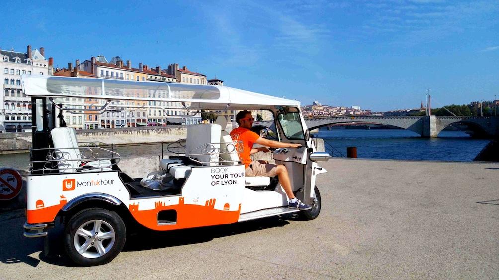 Show item 3 of 6. Tour guide in tuk tuk in Lyon