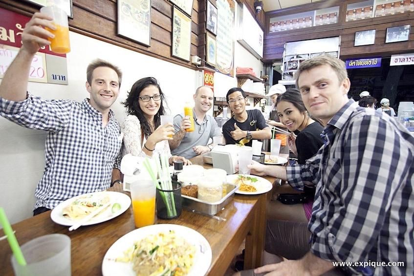 Show item 3 of 5. Tour group enjoying food and drinks in Bangkok