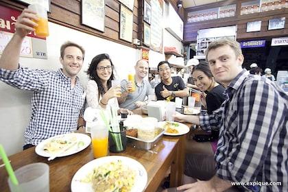 Tour group enjoying food and drinks in Bangkok