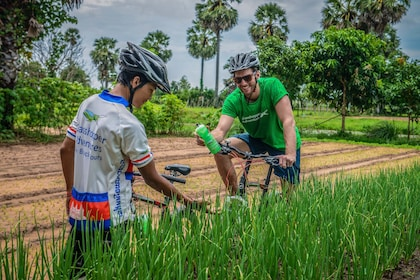 Men on bicycle tour in Cambodia