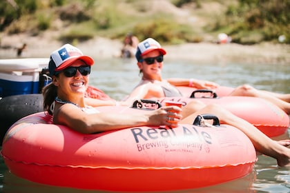 Two women enjoying float down river in Texas