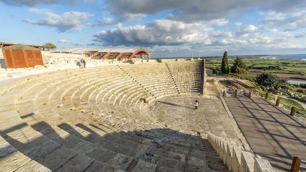 Show item 1 of 10. Person stand at base of ancient amphitheater