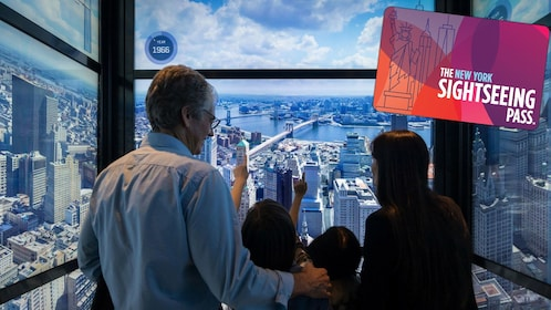 Family in an interactive elevator with a view of the city in New York