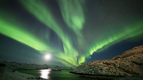 Aurora Borealis over lake in Tromso