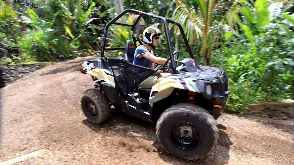 Tampilkan item 5 dari 5. Man turning on the jungle buggies tour in Bali