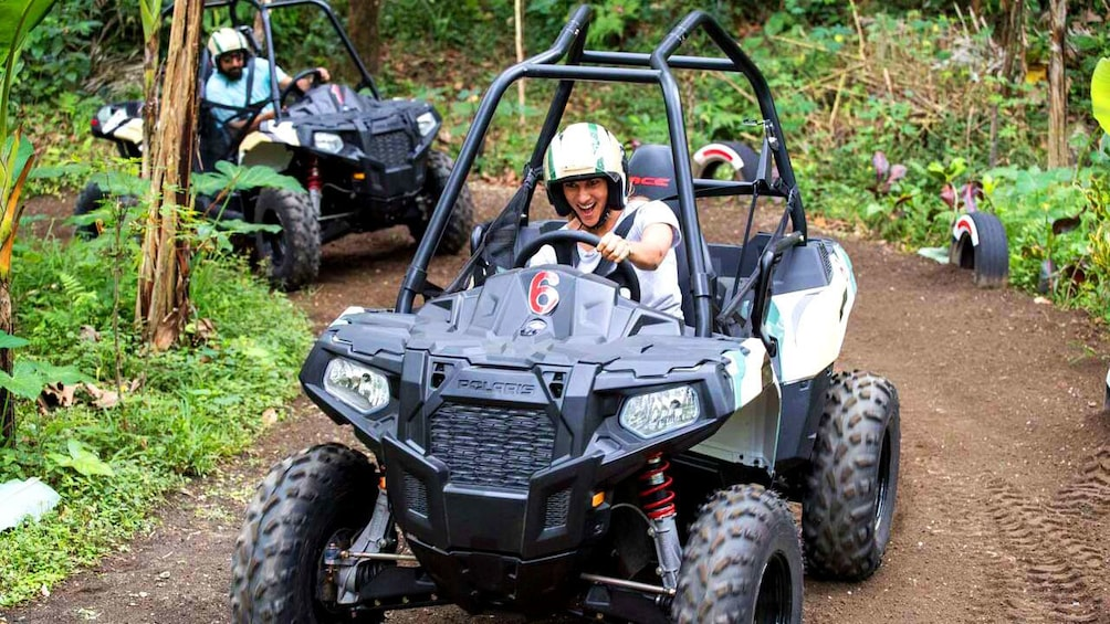 Tampilkan item 2 dari 5. Woman having fun driving on the Jungle Buggies tour in Bali