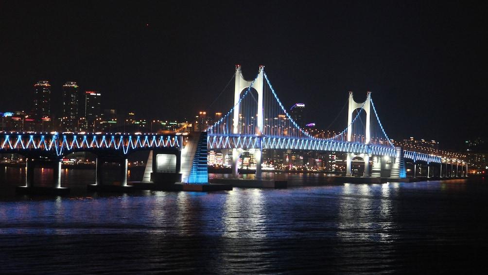 Bridge lit up at night in Busan
