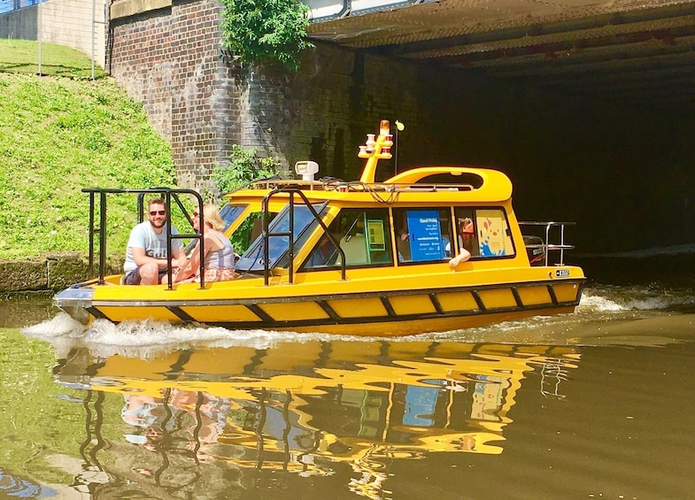 Show item 1 of 6. Full water taxi traveling down river in Manchester