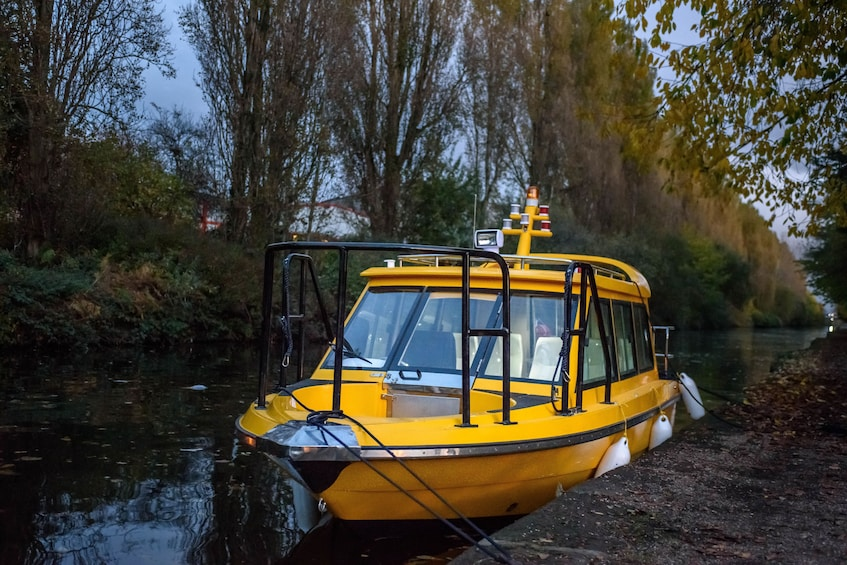 Show item 3 of 6. Water taxi moored along rivers edge in Manchester