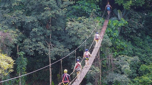 People crossing a rope bridge in Phuket