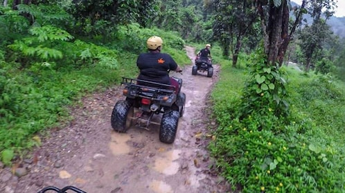 ATV riders on a dirt path in Phuket