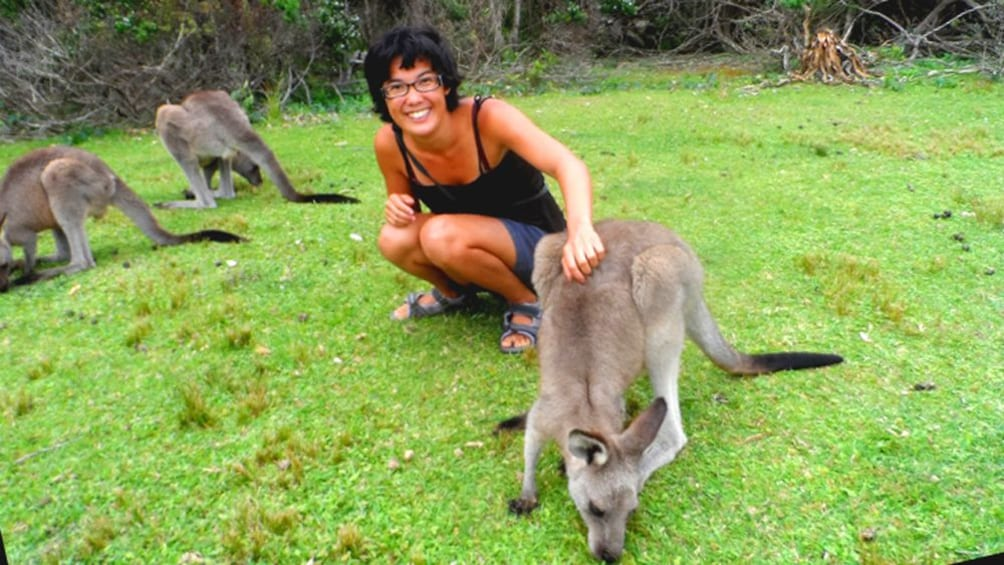 Show item 1 of 5. Woman poses with Kangaroos
