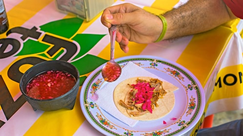 man assembling tacos on a plate in Cozumel