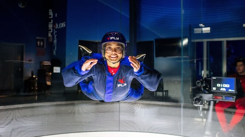 Woman indoor skydiving at iFly Skydiving Experience