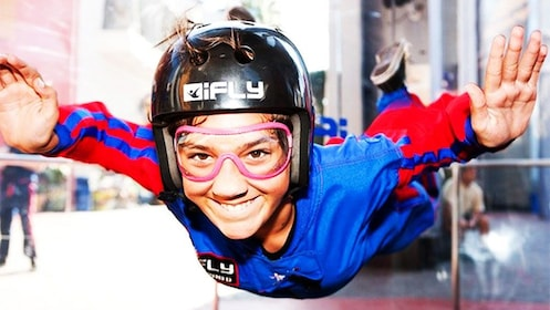 Young woman indoor skydiving at iFly Skydiving Experience