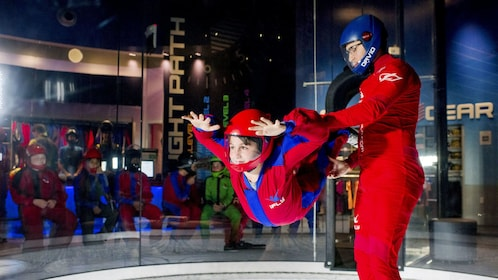 Woman helping young boy skydive at iFly Skydiving Experience