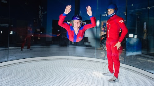 Woman and instructor in an iFly tunnel