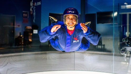 Woman floats in an iFly tunnel